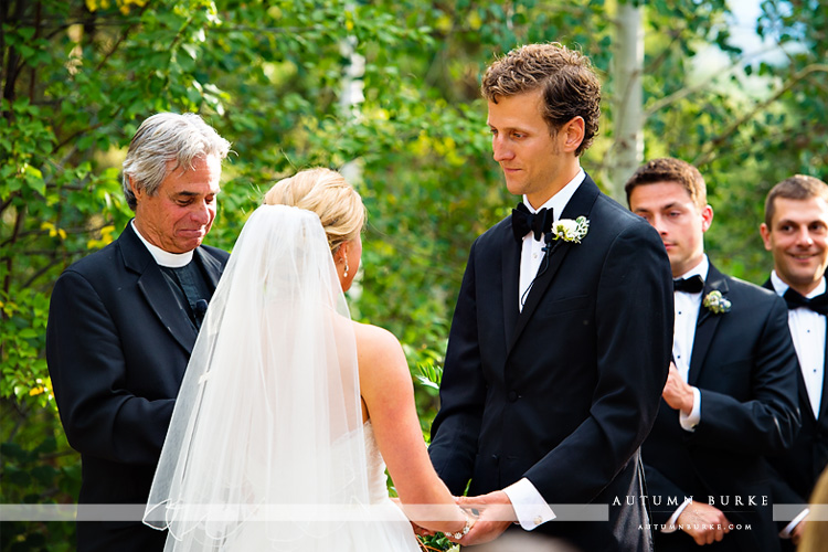 groom during wedding ceremony vows donovan pavilion vail colorado mountain