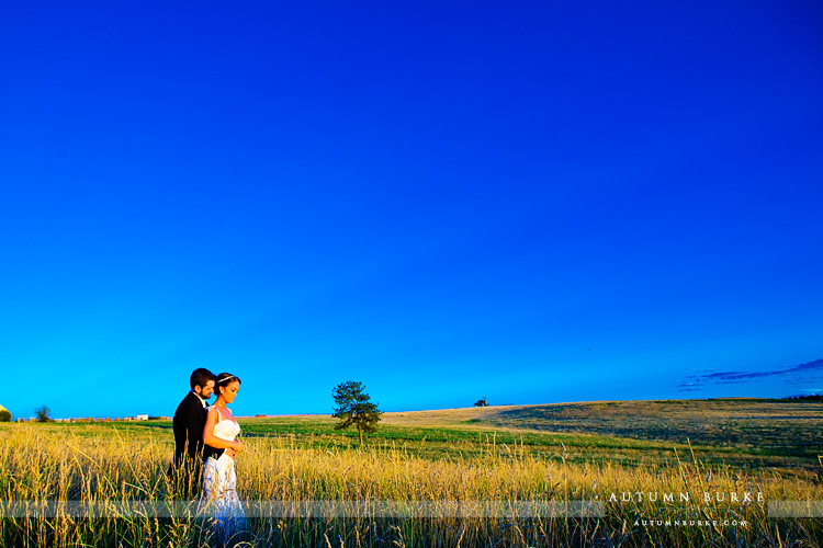 highlands ranch mansion wedding reception bride and groom field sunset