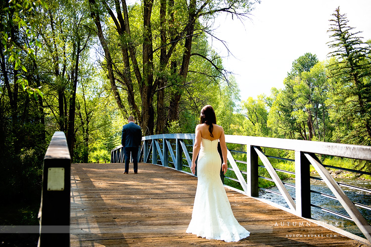 the first look bride and groom on bridge aspen colorado mountain wedding