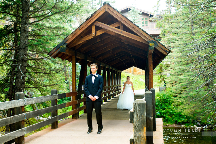 vail colorado mountain wedding bride and groom first look on bridge donovan pavilion