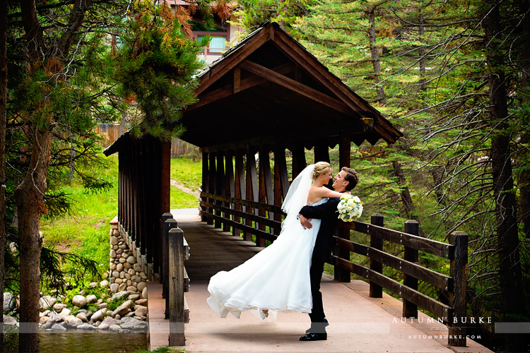 vail colorado mountain wedding donovan pavillion bride and groom first look bridge