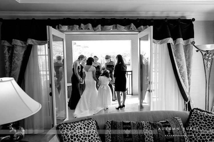 bride and bridesmaids pray before ceremony the broadmoor colorado wedding