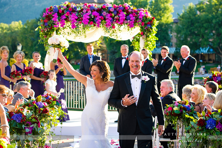 broadmoor wedding ceremony lakeside terrace flower arch just married bride and groom