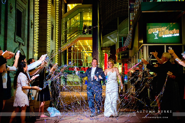 wedding reception grand exit seawell ballroom dcpa denver colorado silver confetti streamers