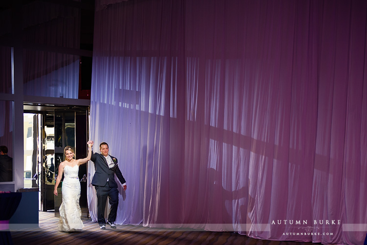 wedding reception seawell ballroom dcpa denver colorado grand entrance bride and groom