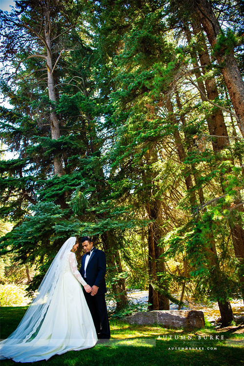 bride and groom first look vail chapel colorado mountain wedding four seasons