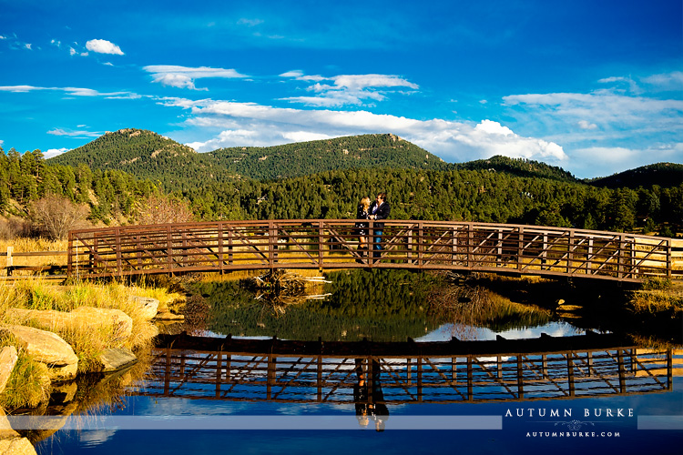 colorado wedding engagement session mountain lake bridge reflection evergreen portrait