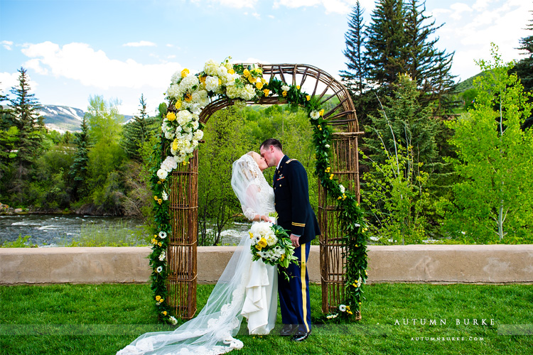 beaver creek westin riverfront wedding ceremony flower arch colorado mountain wedding
