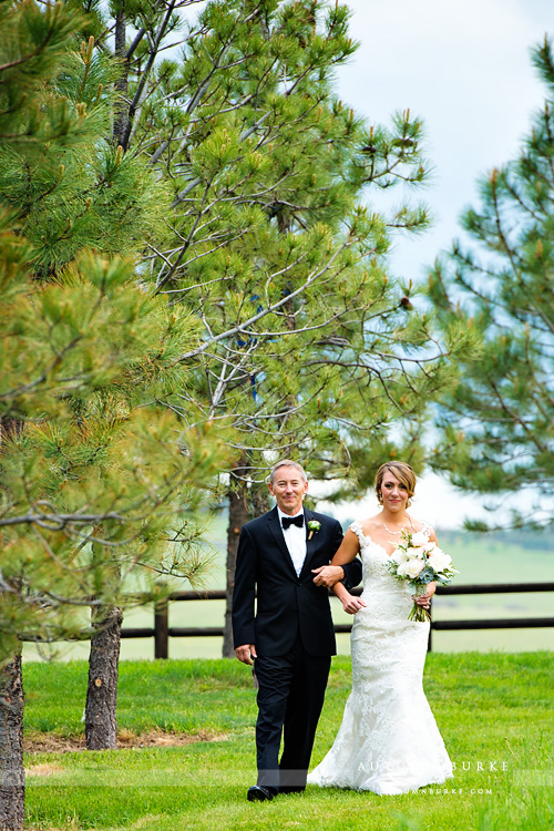 bride walking down aisle with dad spruce mountain ranch wedding ceremony graces chapel larkspur colorado