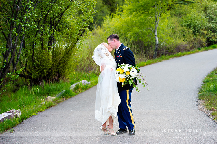 colorado mountain wedding beaver creek westin bride and groom by river