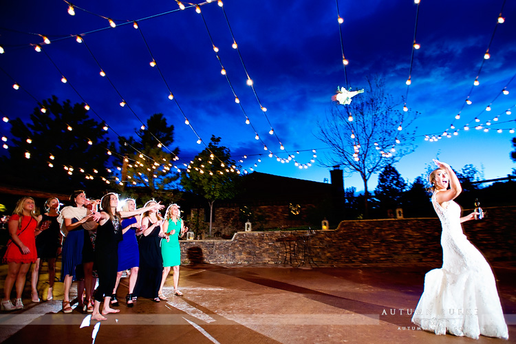 spruce mountain ranch bouquet toss wedding reception bride market lights