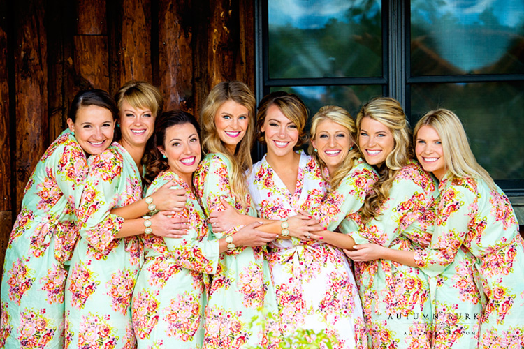 spruce mountain ranch bride with bridesmaids custom floral robes getting ready colorado wedding