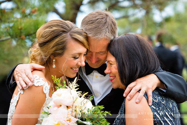 spruce mountain ranch bride with mom and dad family love colorado wedding