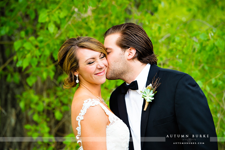 spruce mountain ranch colorado wedding bride and groom nose squinch