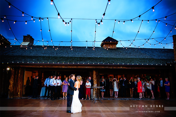 spruce mountain ranch wedding reception courtyard first dance market lights
