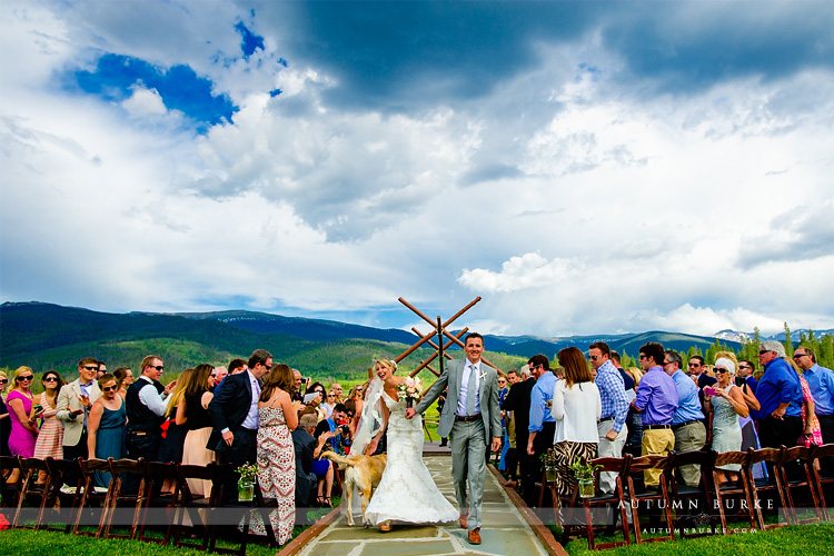 devils thumb ranch colorado mountain wedding ceremony just married bride and groom aisle