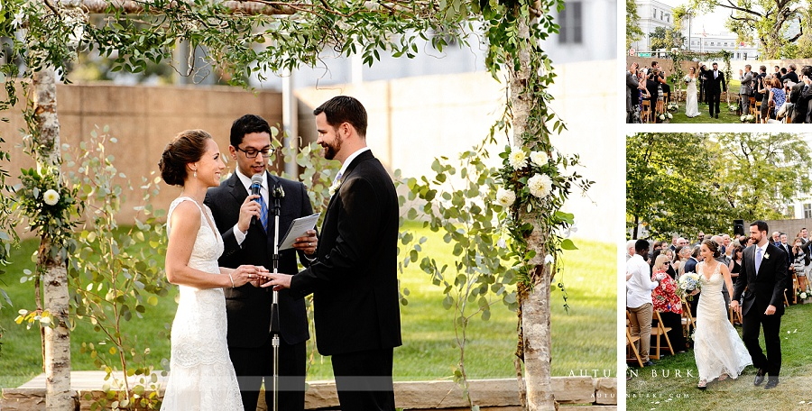 custom chuppah made of flowers and branches denver art museum wedding ceremony bride and groom rings vows colorado