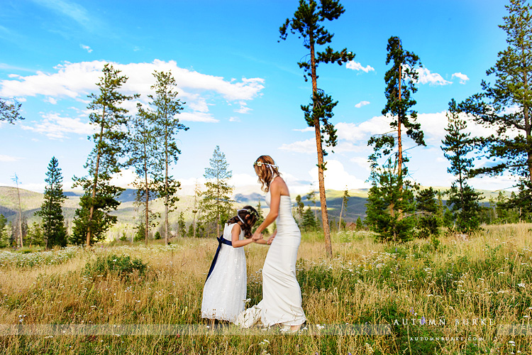 wild horse inn winter park colorado mountain wedding bride and flower girl in field