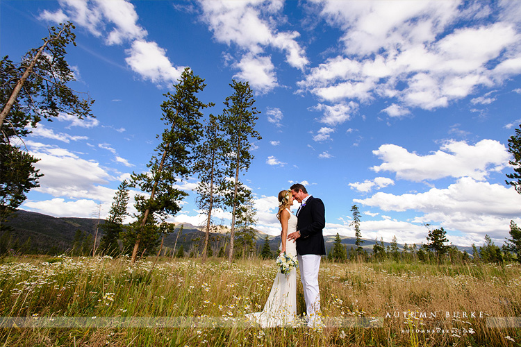 wild horse inn winter park wedding bride and groom mountains field rustic colorado