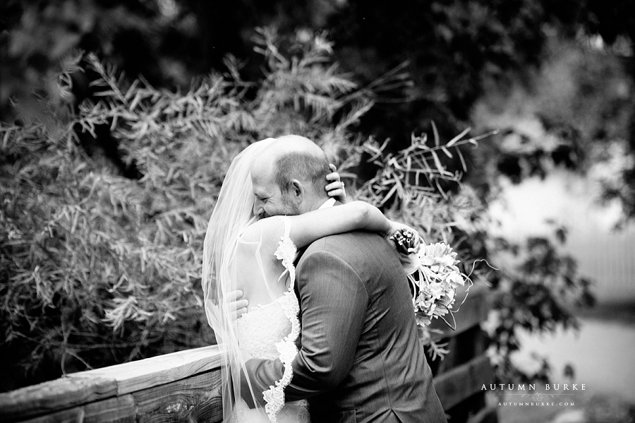 bride and groom embrace colorado wedding chatfield botanic gardens