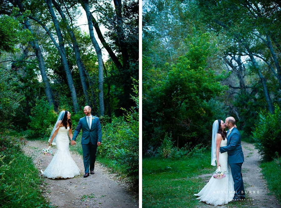 colorado wedding bride and groom walking through woods chatfiled botanic gardens wedding