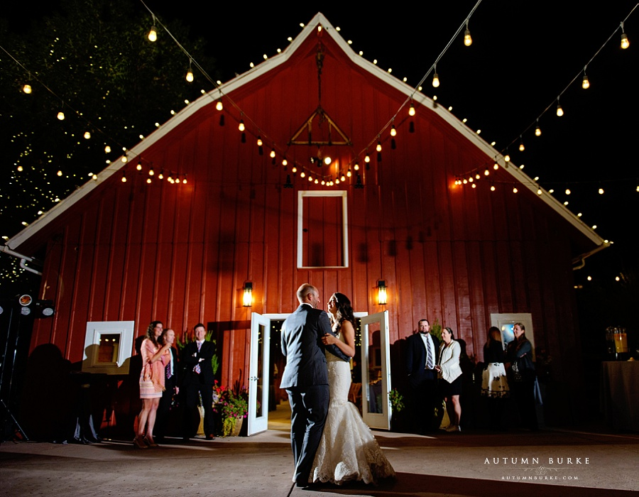 chatfield botanic gardens barn wedding first dance outdoors night market lights bride and groom