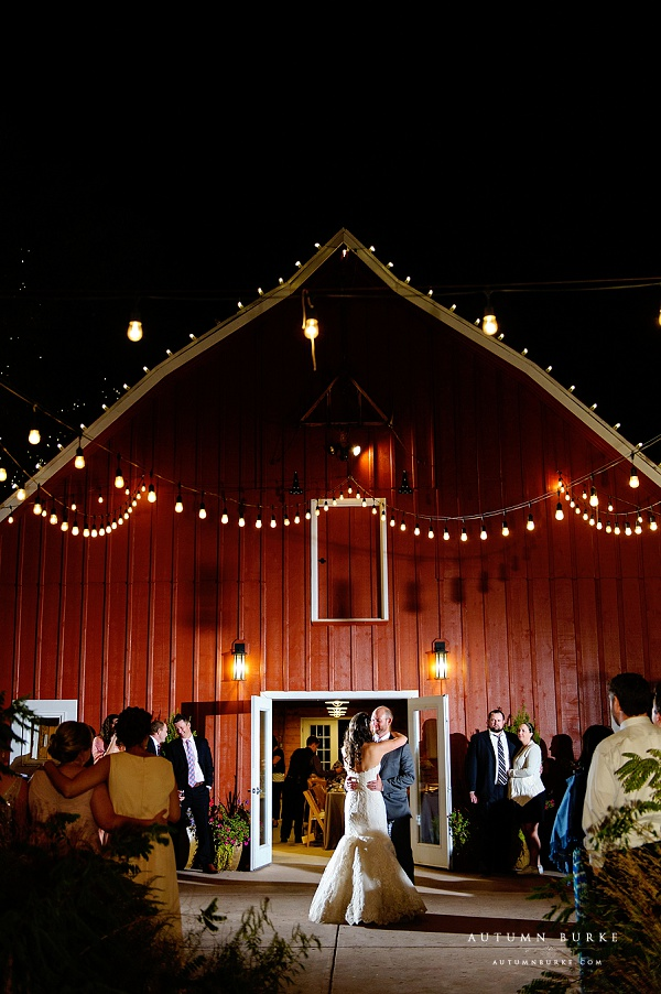 bride and groom first dance in front of barn chatfield botanic gardens outdoor wedding