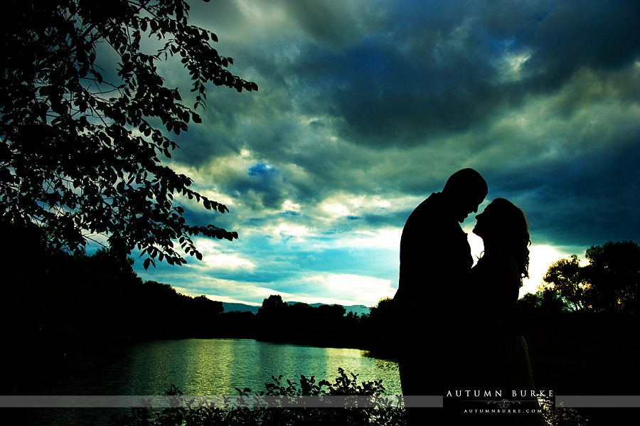 denver colorado wedding bride and groom portrait sunset silhouette lake