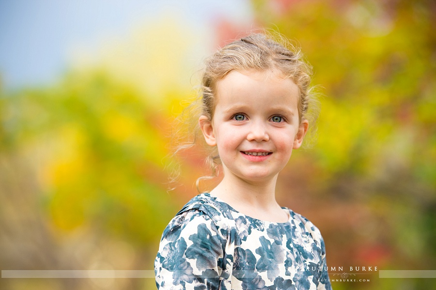 family portraits colorado fall autumn leaves children kids playful