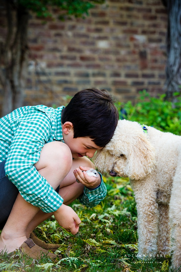 colorado lifestyle portrait boy and gerbil and dog family pets