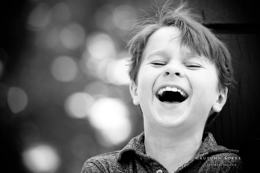 colorado kids portrait childrens photography black and white unbridled laughter portrait boy emotion
