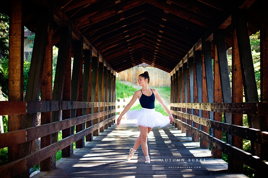 colorado ballerina portrait high school senior pointe shoes bridge outdoors rustic
