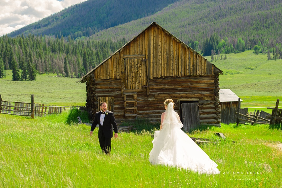 keystone ranch wedding bride and groom first look rustic barn