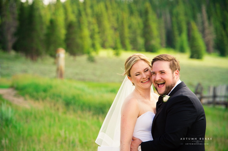 bride and groom candid moment love and laughter keystone ranch wedding colorado