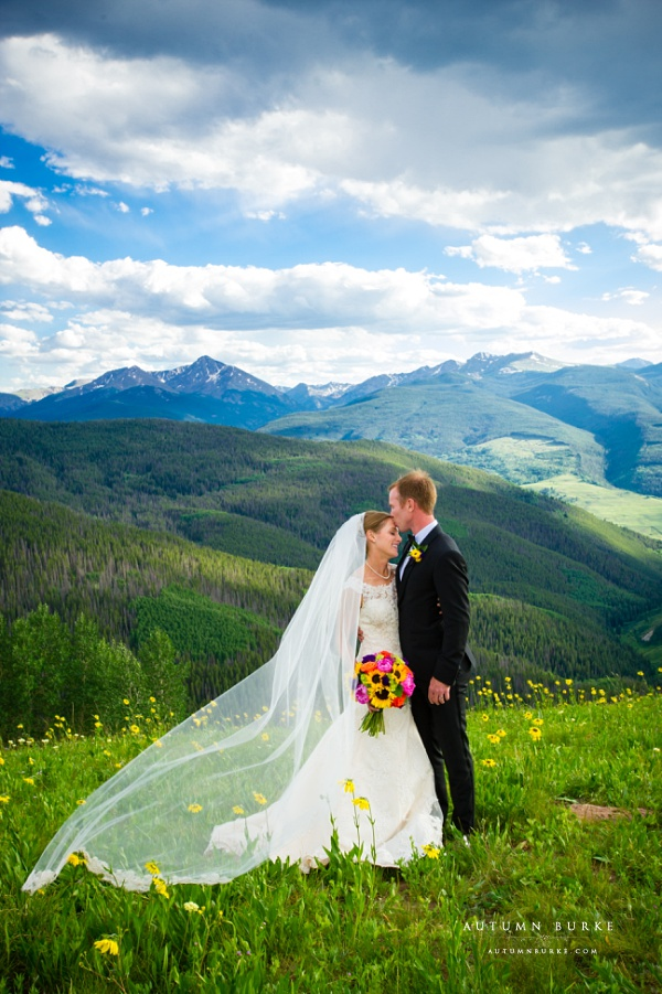 bride and groom mountaintop vail wedding deck ceremony