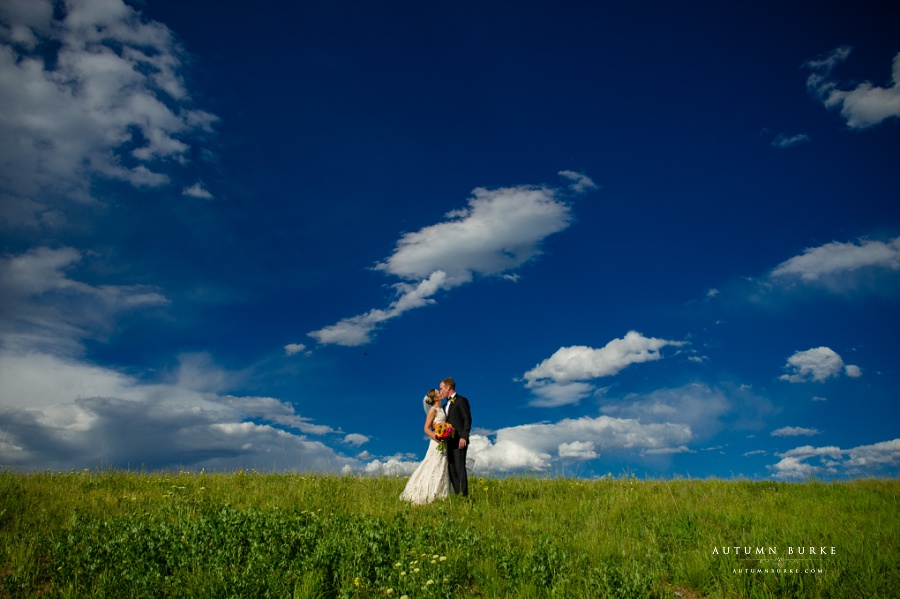 vail colorado mountain wedding vail wedding deck bluebird sky bride and groom portrait